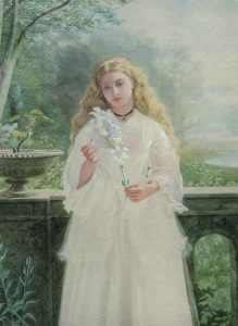 Portrait of a girl holding a lily